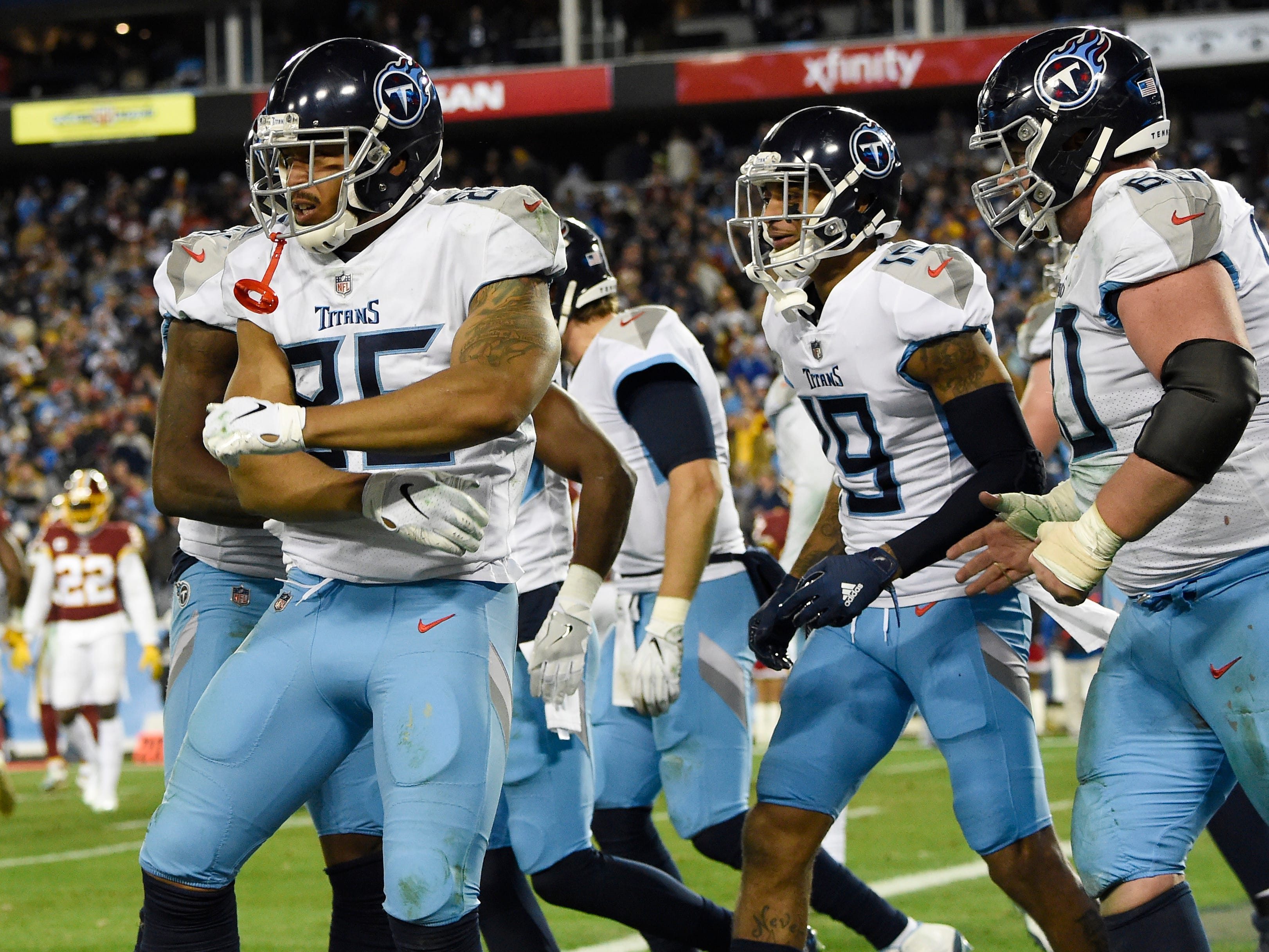 Titans tight end MyCole Pruitt (85) celebrates his touchdown with teammates in the fourth quarter at Nissan Stadium Saturday, Dec. 22, 2018, in Nashville, Tenn.