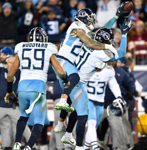 Titans safety Kevin Byard (31) celebrates his interception with safety Kenny Vaccaro (24) in the fourth quarter Saturday.