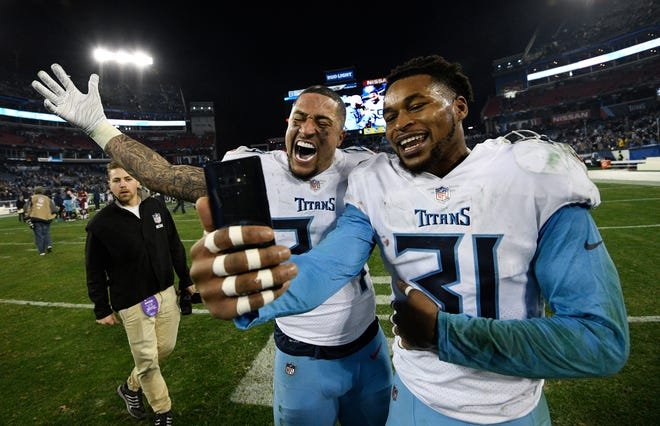 No. 20-Kevin Byard: Tennessee Titans safeties Byard (31) and Kenny Vaccaro (24) take a selfie on the field after the team's 25-16 win over the Washington Redskins at Nissan Stadium Dec. 22, 2018.