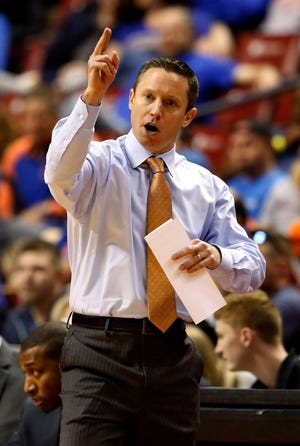 Florida head coach Mike White reacts in the first half of play Florida Gulf Coast of an NCAA college basketball game, part of the Orange Bowl Classic tournament Saturday, Dec. 22, 2018, in Sunrise, Fla. Florida won the game 77-56. (AP Photo/Joe Skipper)