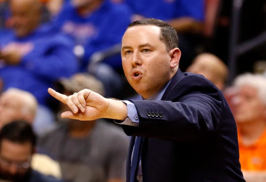 Florida Gulf Coast coach Michael Fly gestures during the team's game against Florida at the Orange Bowl Classic on Saturday in Sunrise. Florida won 77-56.