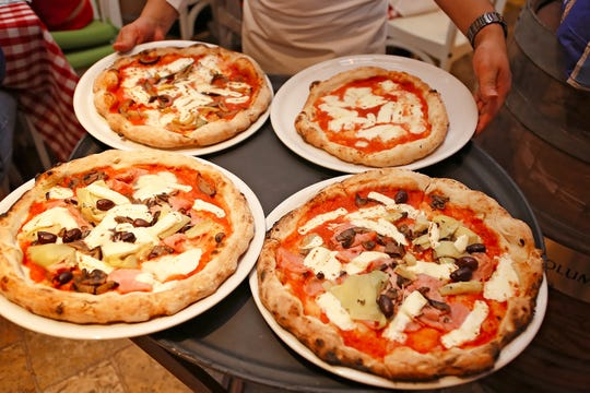 Neapolitan-style pizza is the specialty at the new La Trattoria on Fifth Avenue South in downtown Naples.