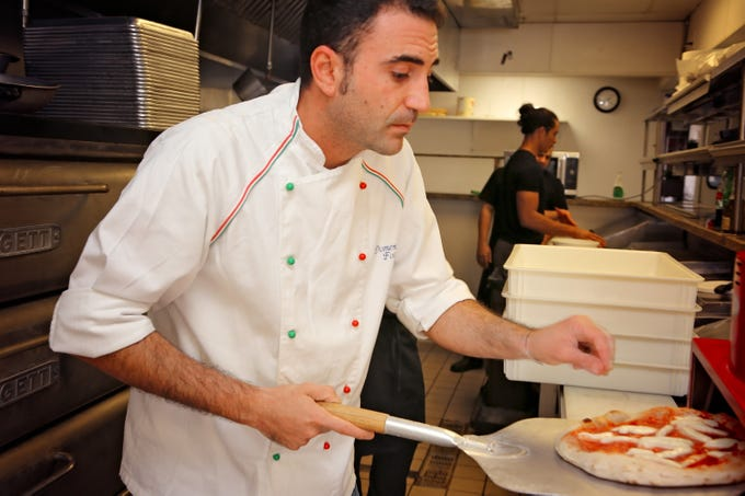 Domenico Foraggio, an award-winning, third-generation pizza chef from Naples, Italy, is in the kitchen at La Trattoria, which recently opened on Fifth Avenue South in downtown Naples.