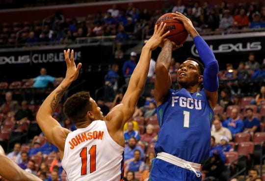 Florida Gulf Coast forward Troy Baxter Jr. (1) shoots over Florida forward Keyontae Johnson (11) in the second half of a game, part of the Orange Bowl Classic tournament Saturday in Sunrise.