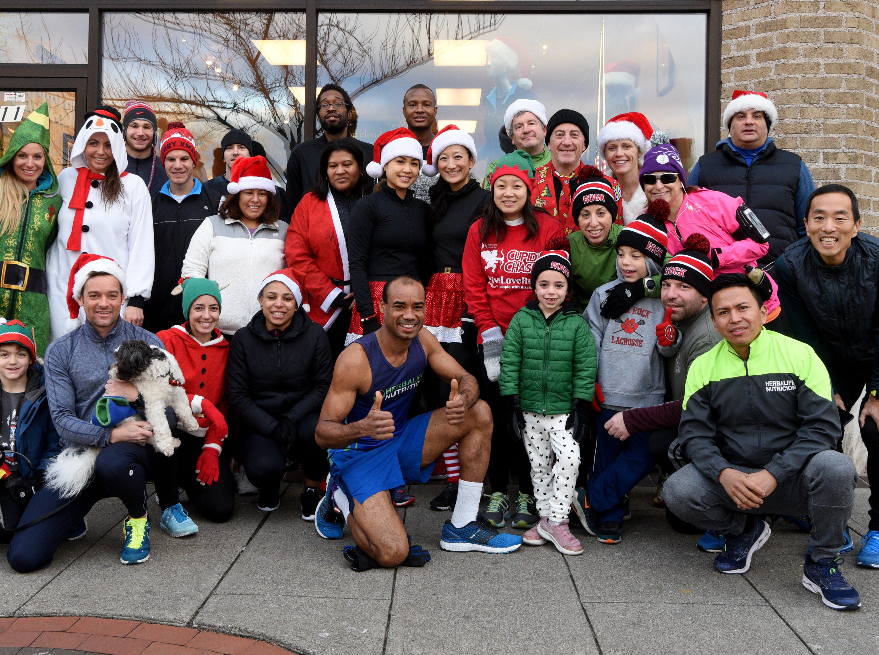 Racefaster Ridgewood organized a fun Santa Run on Sunday, December 23, 2018. The run left from the store on N. Broad St. and offered runs for varying levels and distances. Participants pose for a picture prior to leaving on the run.
