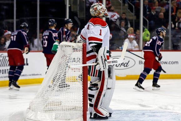 New Jersey Devils goaltender Keith Kinkaid (1) reacts after giving up a goal to Columbus Blue Jackets' Oliver Bjorkstrand during the first period of an NHL hockey game Sunday, Dec. 23, 2018, in Newark, N.J.