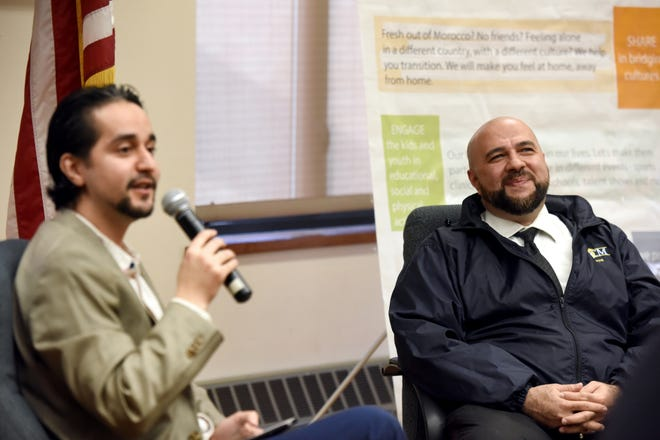 Yassine Elkaryani, on left, serves as the moderator for a conversation with Prospect Park Mayor Mohamed T. Khairullah. Khairullah provided insight and tips for the average person to start their involvement in local politics during the event at the Secaucus Public Library on Sunday, December 23, 2018. The Moroccan American Recreational Organization Council (MAROC) organized the event.