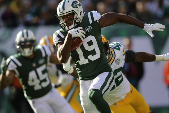 Andre Roberts runs with the ball after catching the punt from the Packers in the first half.   Sunday, December 23, 2018