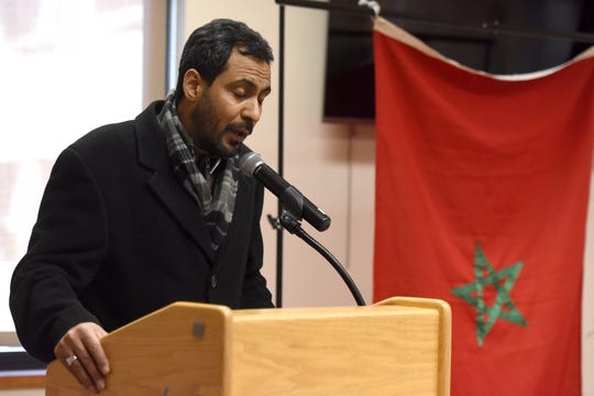 Anas Labsir of Clifton, recites a verse from the Quran to open an event held by the Moroccan American Recreational Organization Council (MAROC) at the Secaucus Public Library on Sunday, December 23, 2018.