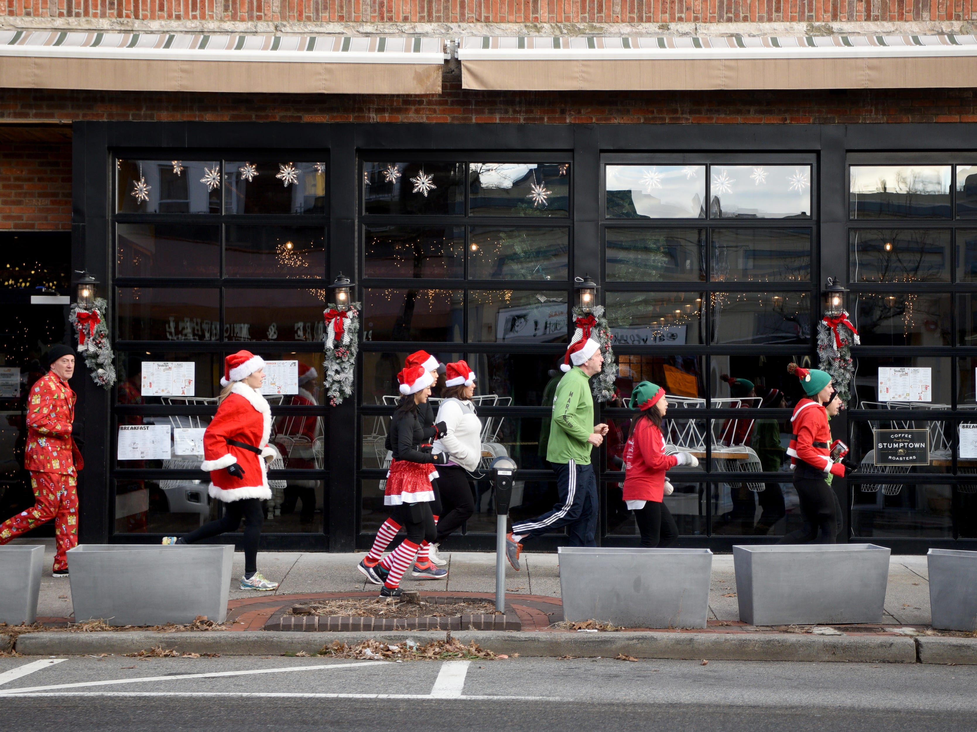 Racefaster Ridgewood organized a fun Santa Run on Sunday, December 23, 2018. A group of runners make their way down E. Ridgewood Ave.