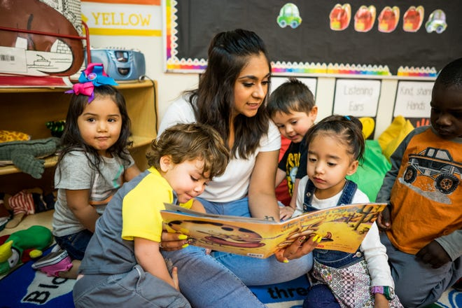 Students at the Western New Mexico University Early Childhood Programs' lab site, the Child Development Center, participate in story time.