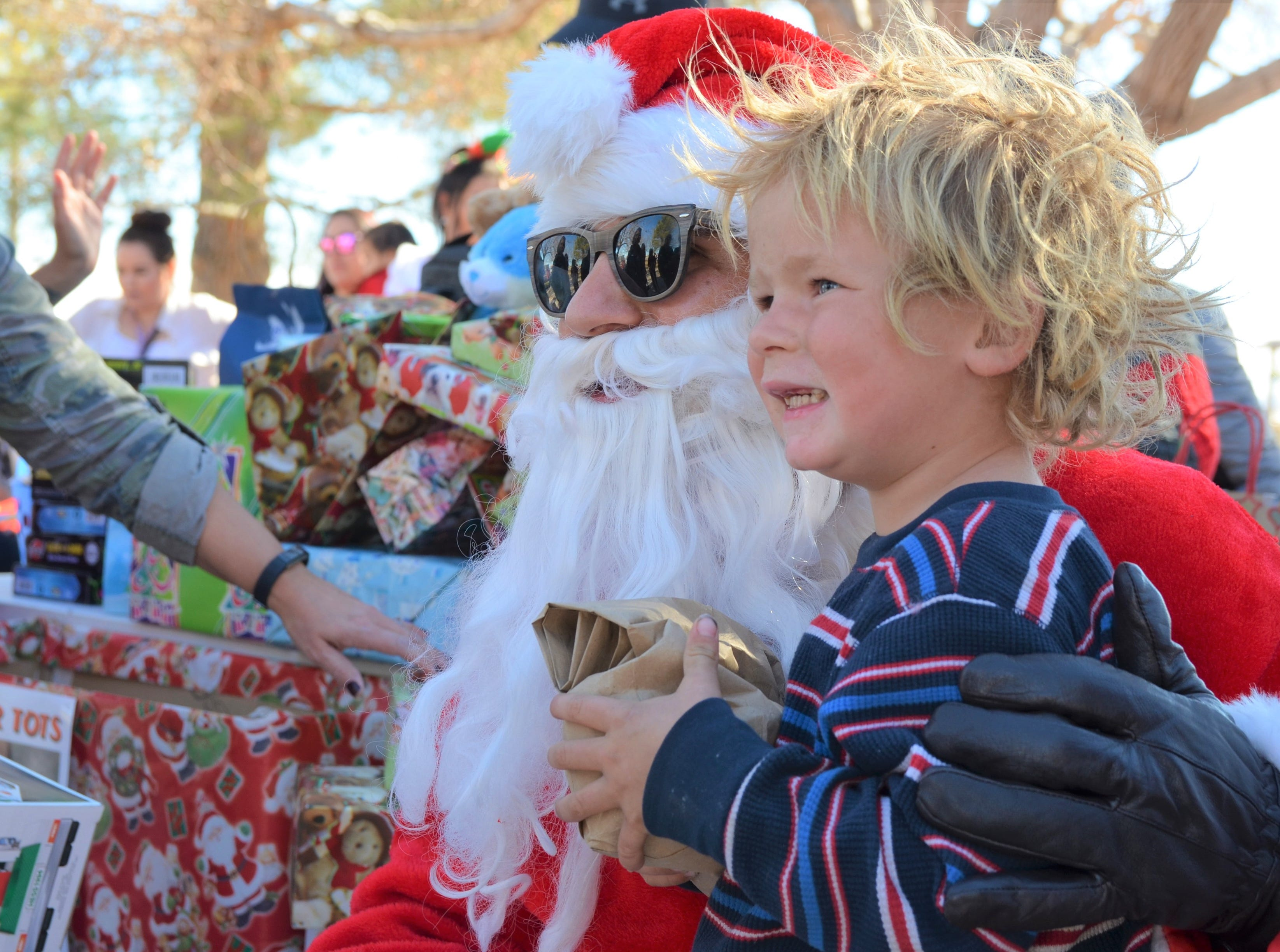Tj, 4, received a fire truck and a bag of candies after meeting with Santa Claus.
