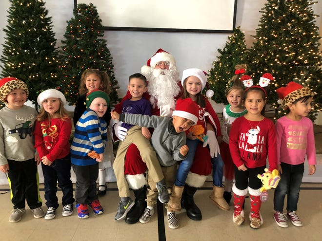 Santa Claus paid a visit to pre-school students at the Fruit of the Vine Preschool located at 615 S. Copper Street in Deming, NM. Mrs. Maggie Armijo invited the jolly man in the red suit to visit each year and he doesn't disappoint. Students were treated to a visit with St. Nick and a Christmas holiday party.