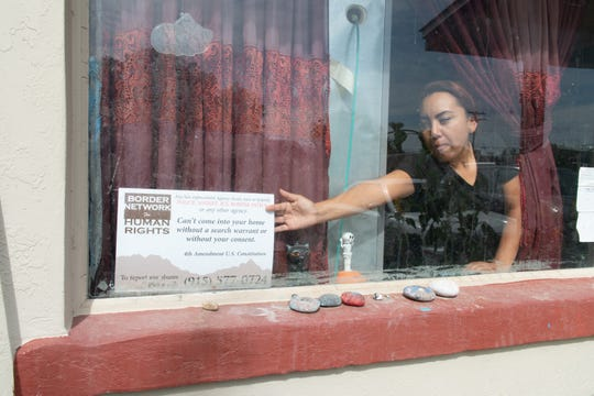 Nayeli Saenz keeps a sign in her window reminding law enforcement that a warrant is required to enter her Las Cruces house.