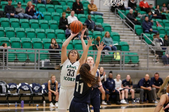 Farmington's Chloe Finch makes a basket against Rio Rancho during Saturday's game at Scorpion Arena.