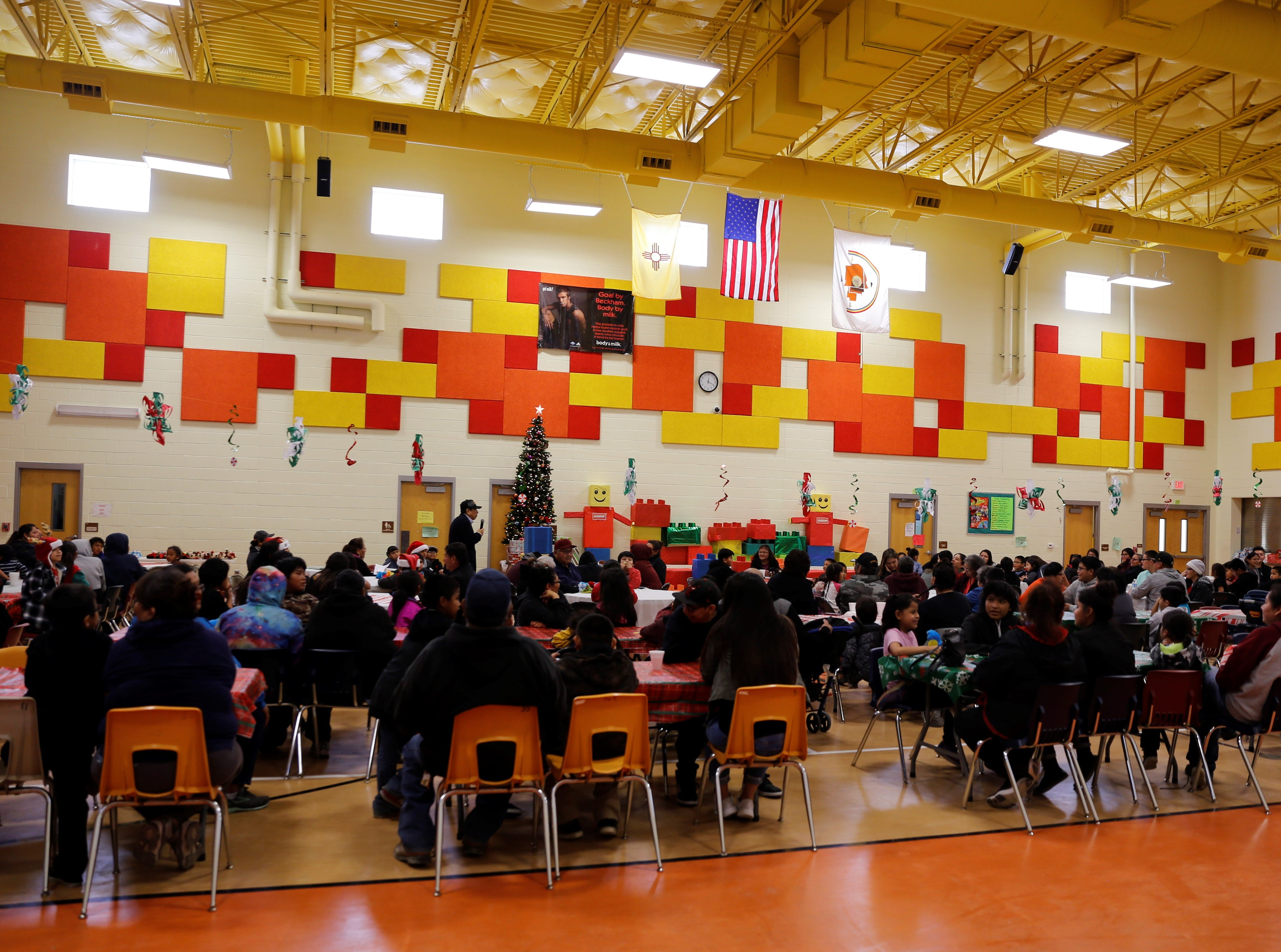 Families wait for gifts to be distributed to children on Saturday at the Shiprock Youth Complex.