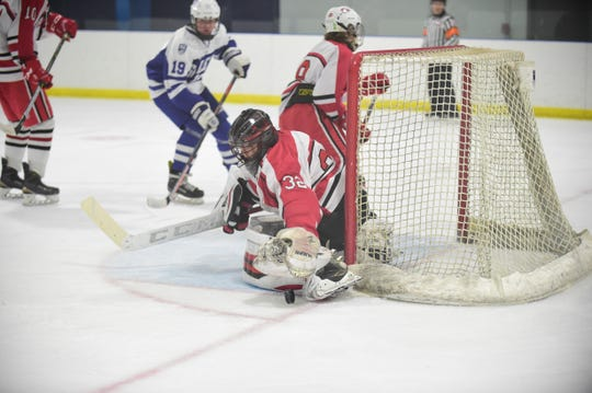 Making one of his 47 stops Saturday night is Canton netminder Jaxon Tayler (32).