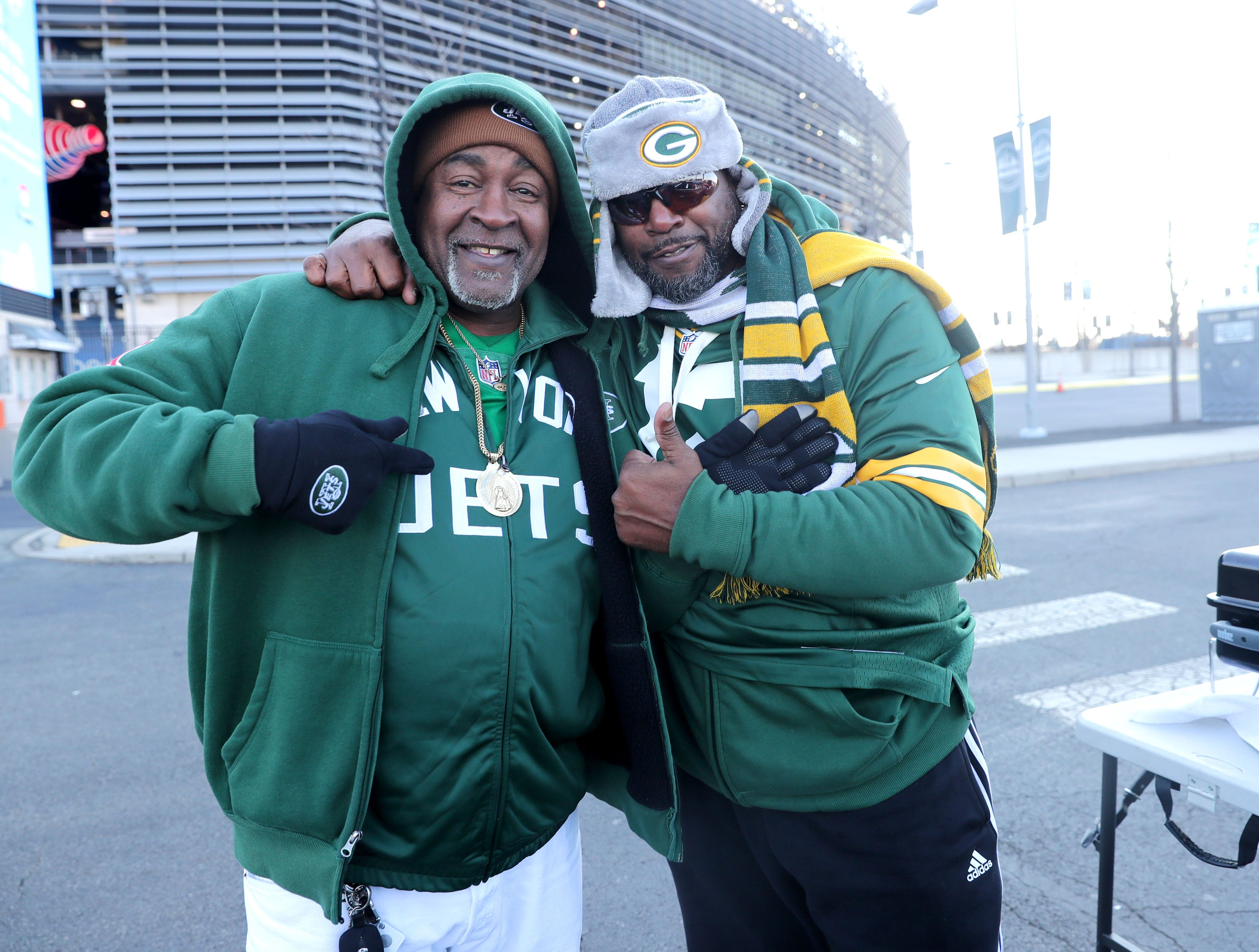 New York Jets  fan Ernest Powell, from Verplanck, New York and Green Bay Packers fan  Maurice Graham, from Poughkeepsie, New York don their Jets and Packers gear while tailgating before the Green Bay Packers game against the New York Jets at MetLife Stadium Sunday, Dec. 23, 2018, in East Rutherford.