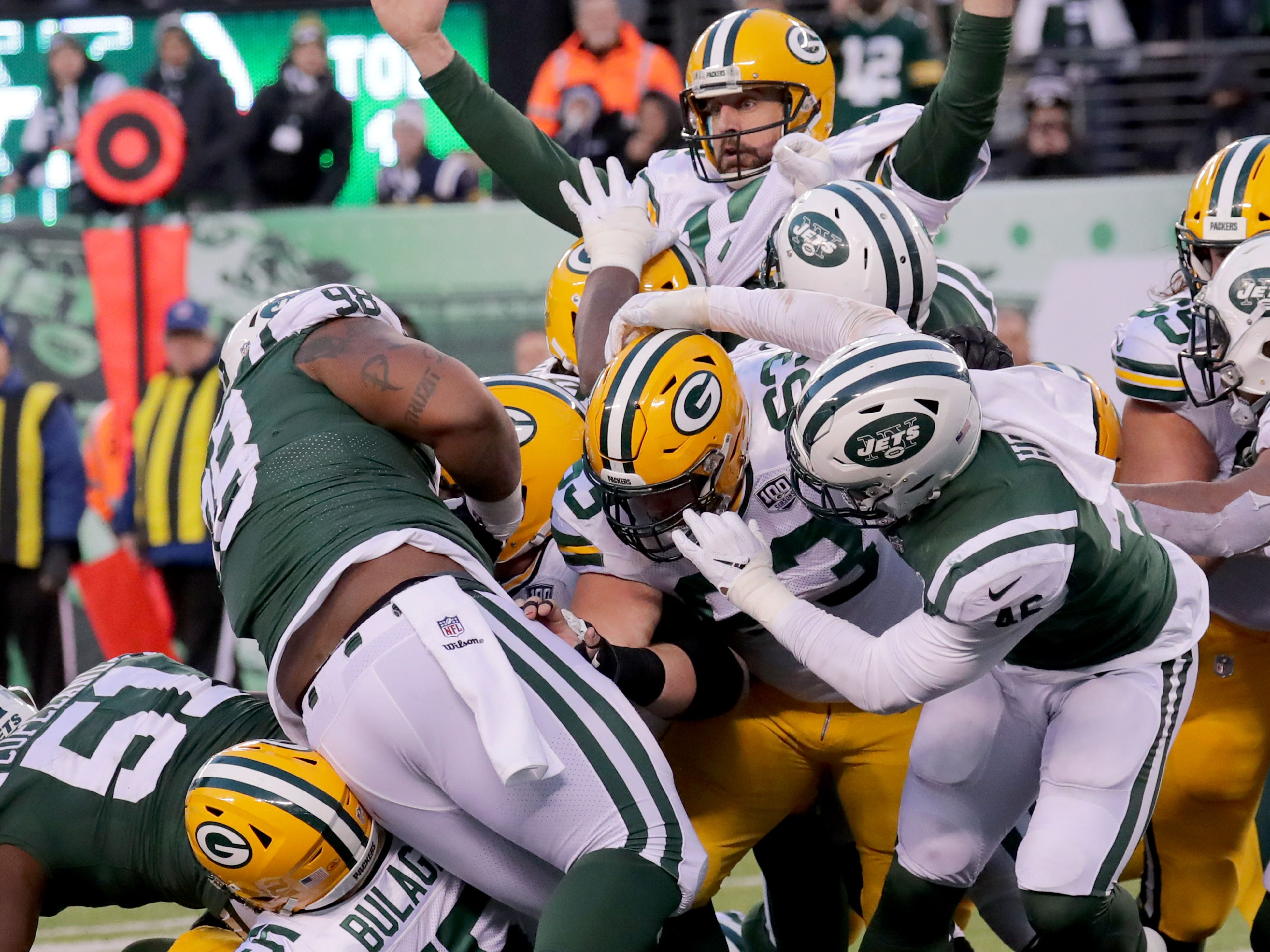 Green Bay Packers' Aaron Rodgers signals a touchdown after he reached across the goal line for the score during the 2nd half of Packers 44-38 overtime win against the New York Jets at MetLife Stadium Sunday, Dec. 23, 2018, in East Rutherford.