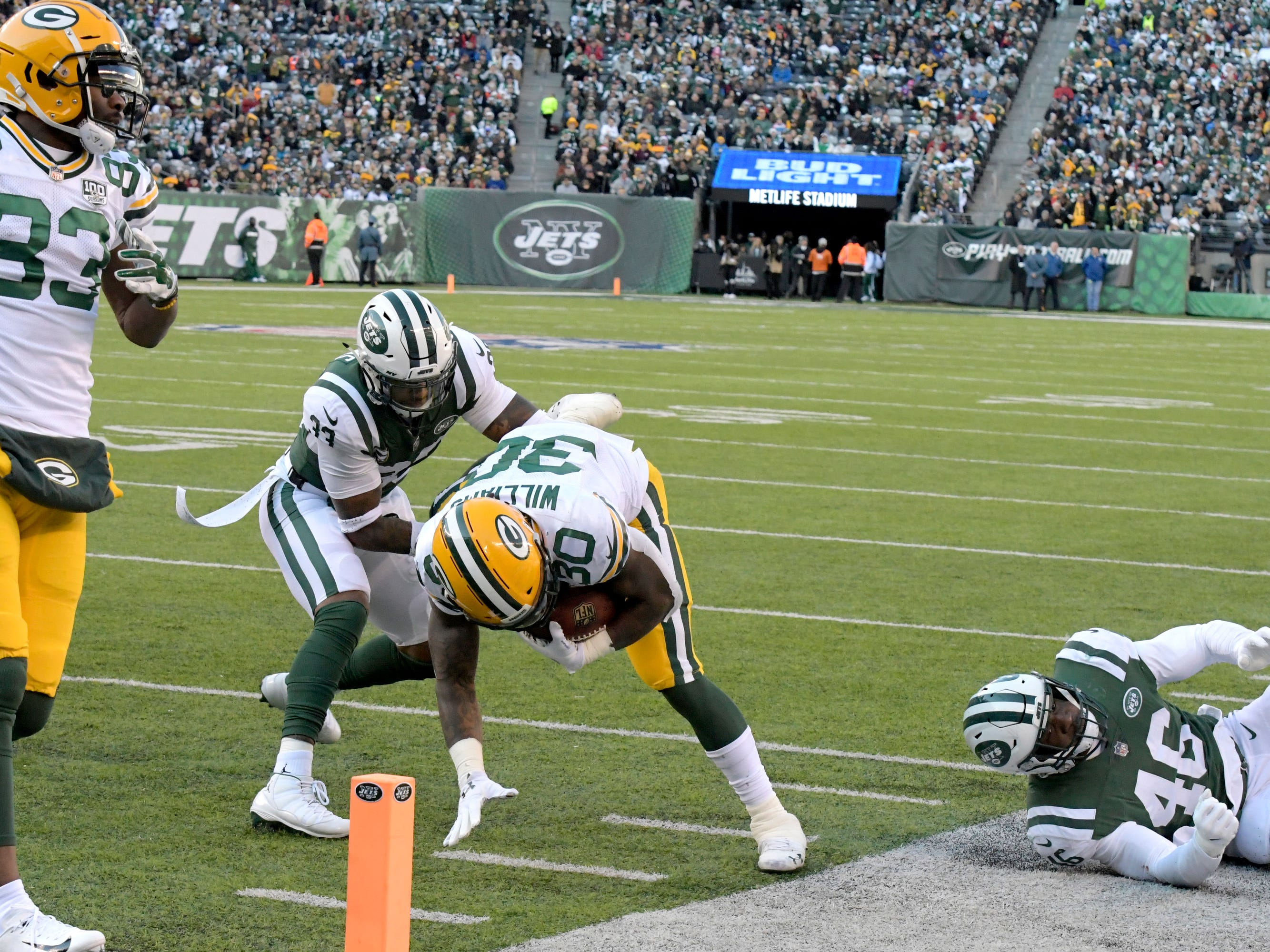 Green Bay Packers running back Jamaal Williams (30) leaps toward the end zone as New York Jets strong safety Jamal Adams tries to stop him during the first half of an NFL football game, Sunday, Dec. 23, 2018, in East Rutherford, N.J. Williams scored on the play. (AP Photo/Bill Kostroun)