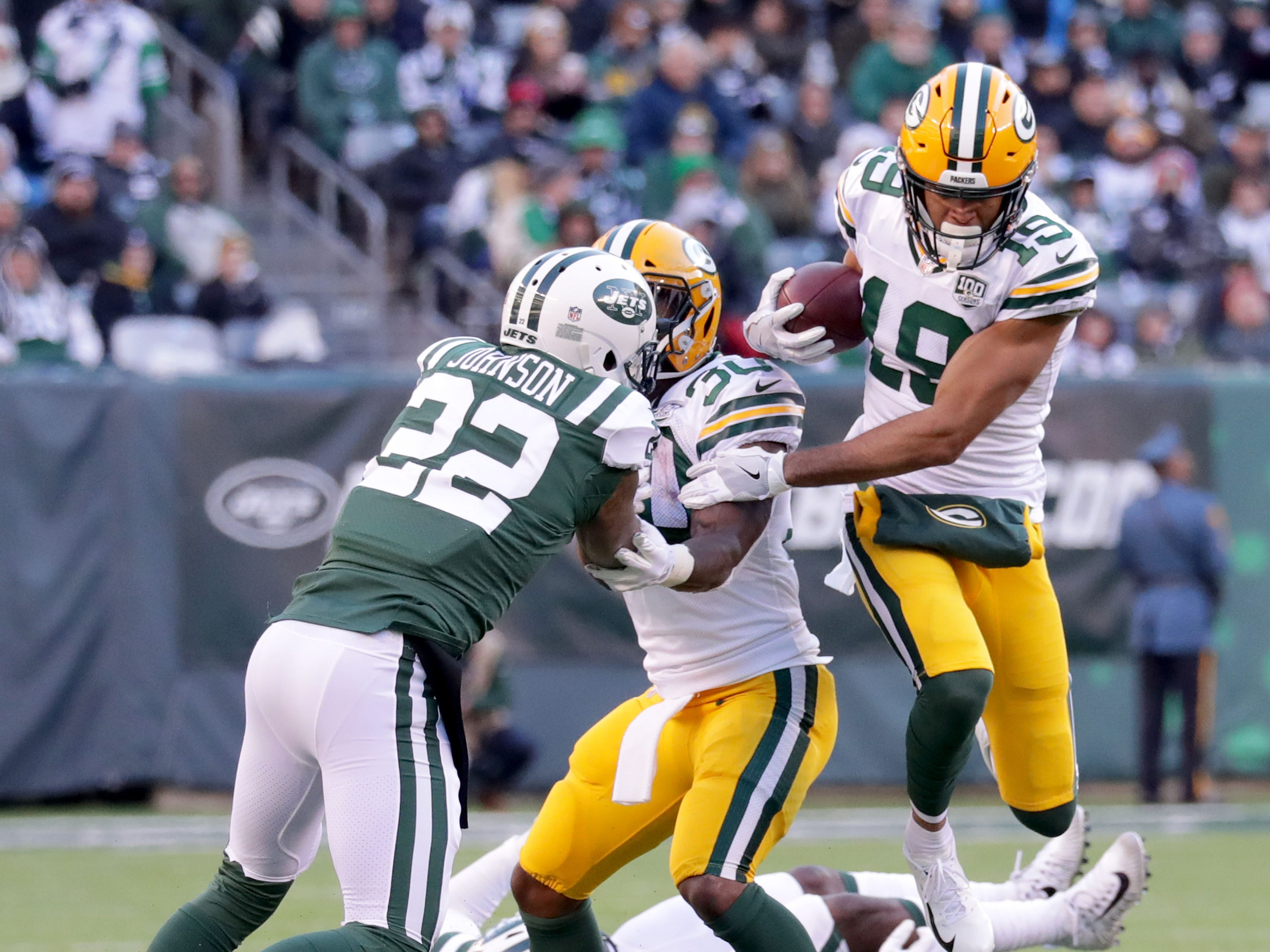 Green Bay Packers' Equanimeous St. Brown runs after the catch as Green Bay Packers' Jamaal Williams (30) blocks New York Jets' Trumaine Johnson (22) during the 2nd half of Packers 44-38 overtime win against the New York Jets at MetLife Stadium Sunday, Dec. 23, 2018, in East Rutherford.
