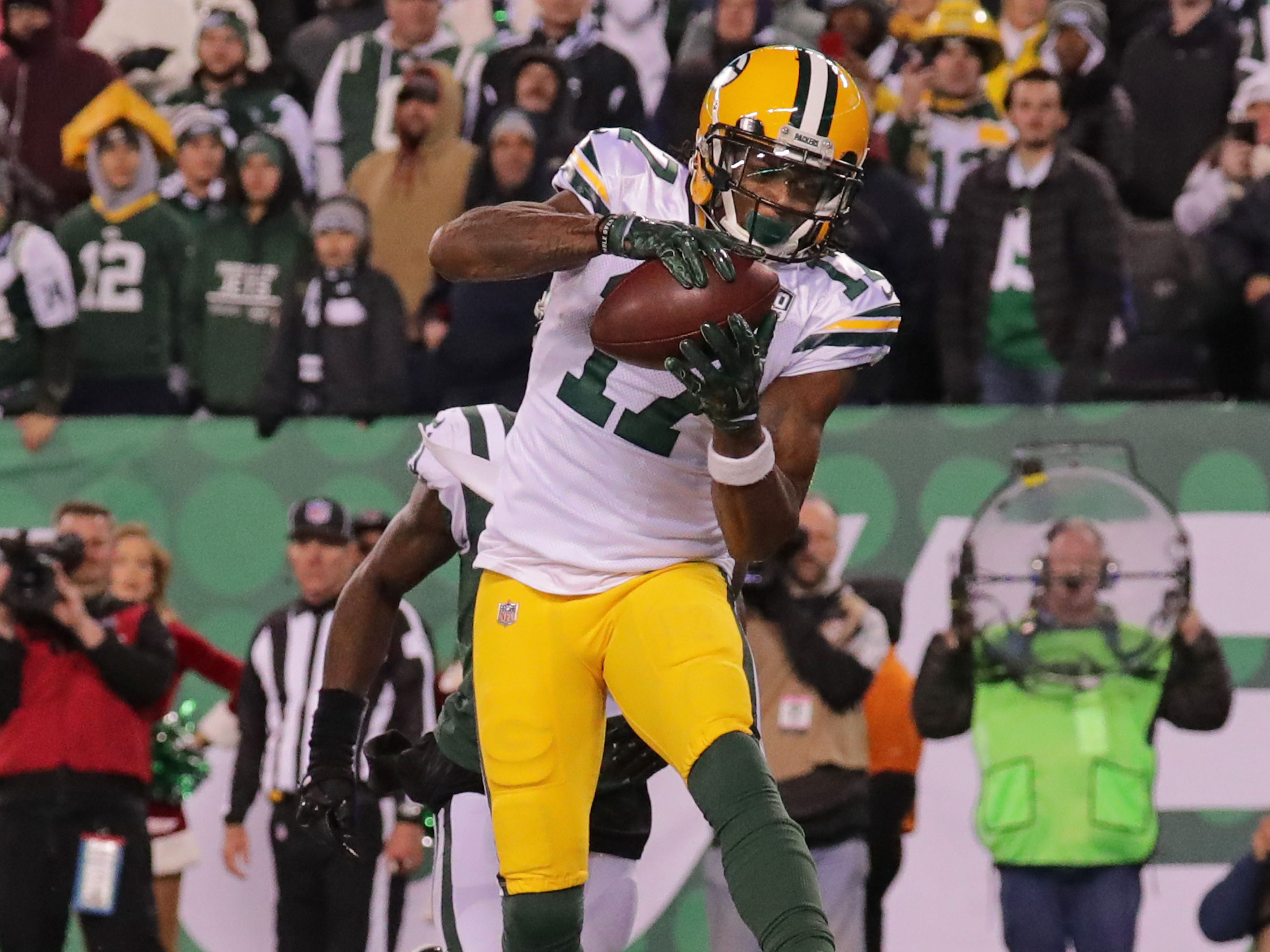 Green Bay Packers' Davante Adams catches the game winning catch past New York Jets' Morris Claiborne during overtime of the of the Green Bay Packers 44-38 win against the New York Jets at MetLife Stadium Sunday, Dec. 23, 2018, in East Rutherford. l