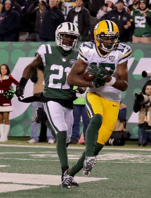 Green Bay Packers' Davante Adams catches the game winning catch past New York Jets' Morris Claiborne during overtime of the of the Green Bay Packers 44-38 win against the New York Jets at MetLife Stadium Sunday, Dec. 23, 2018, in East Rutherford.