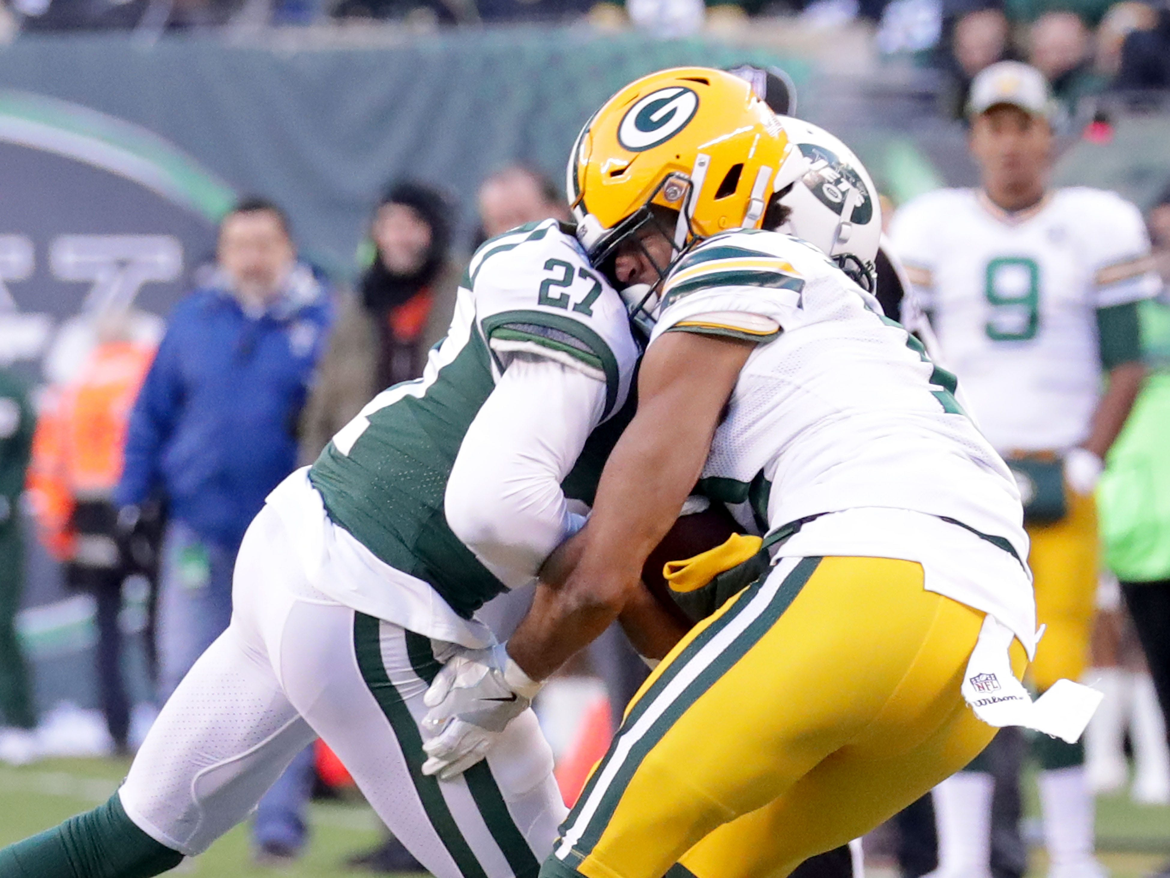 Green Bay Packers' Equanimeous St. Brown takes a blow from New York Jets' Darryl Roberts,  where an unnecessary roughness penalty was called on the Jets for the hit during the 2nd half of Packers 44-38 overtime win against the New York Jets at MetLife Stadium Sunday, Dec. 23, 2018, in East Rutherford.