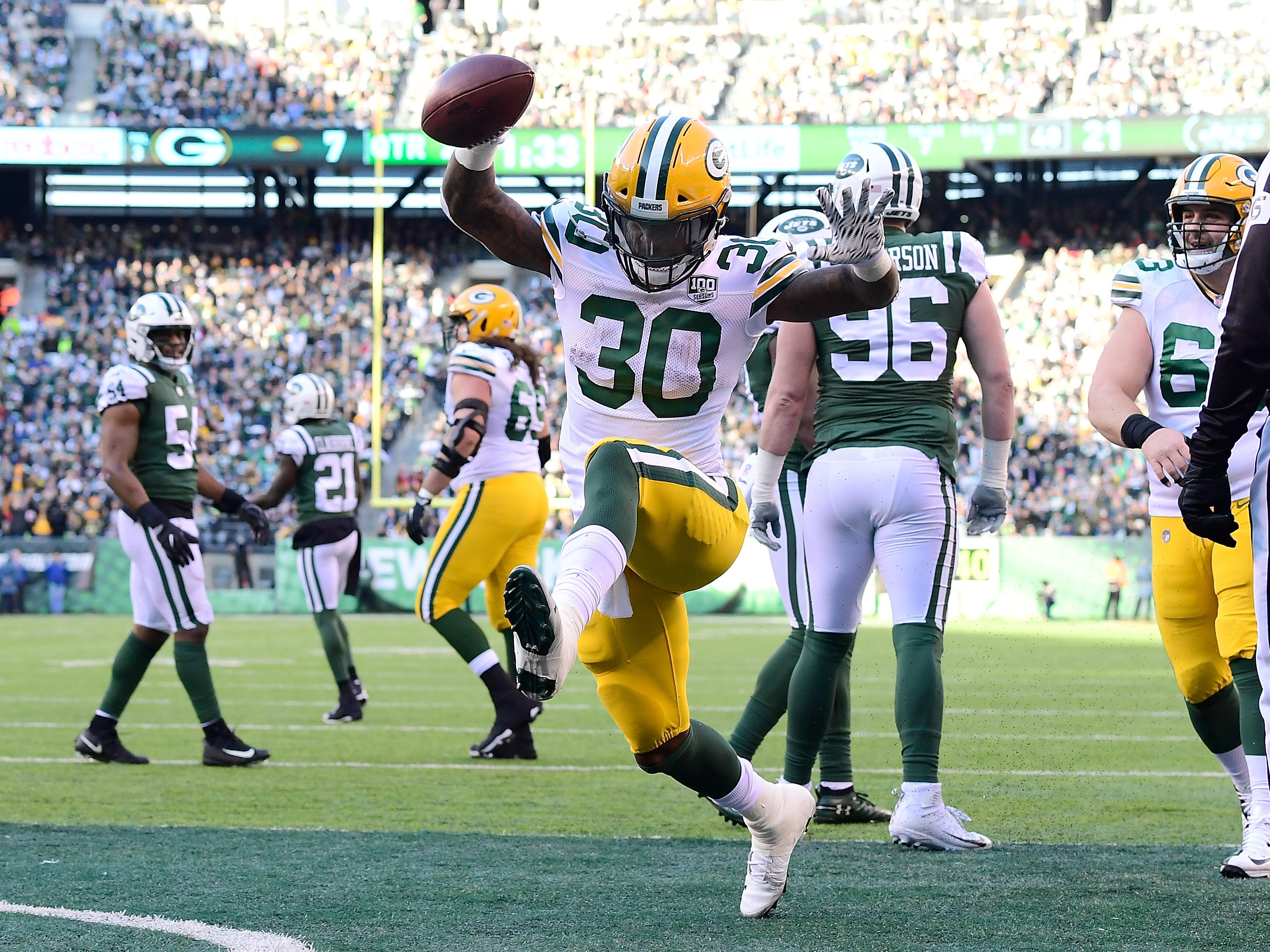 Jamaal Williams of the Green Bay Packers celebrates after scoring a touchdown against the New York Jets during the second quarter at MetLife Stadium on December 23, 2018 in East Rutherford, New Jersey.  (Photo by Steven Ryan/Getty Images)