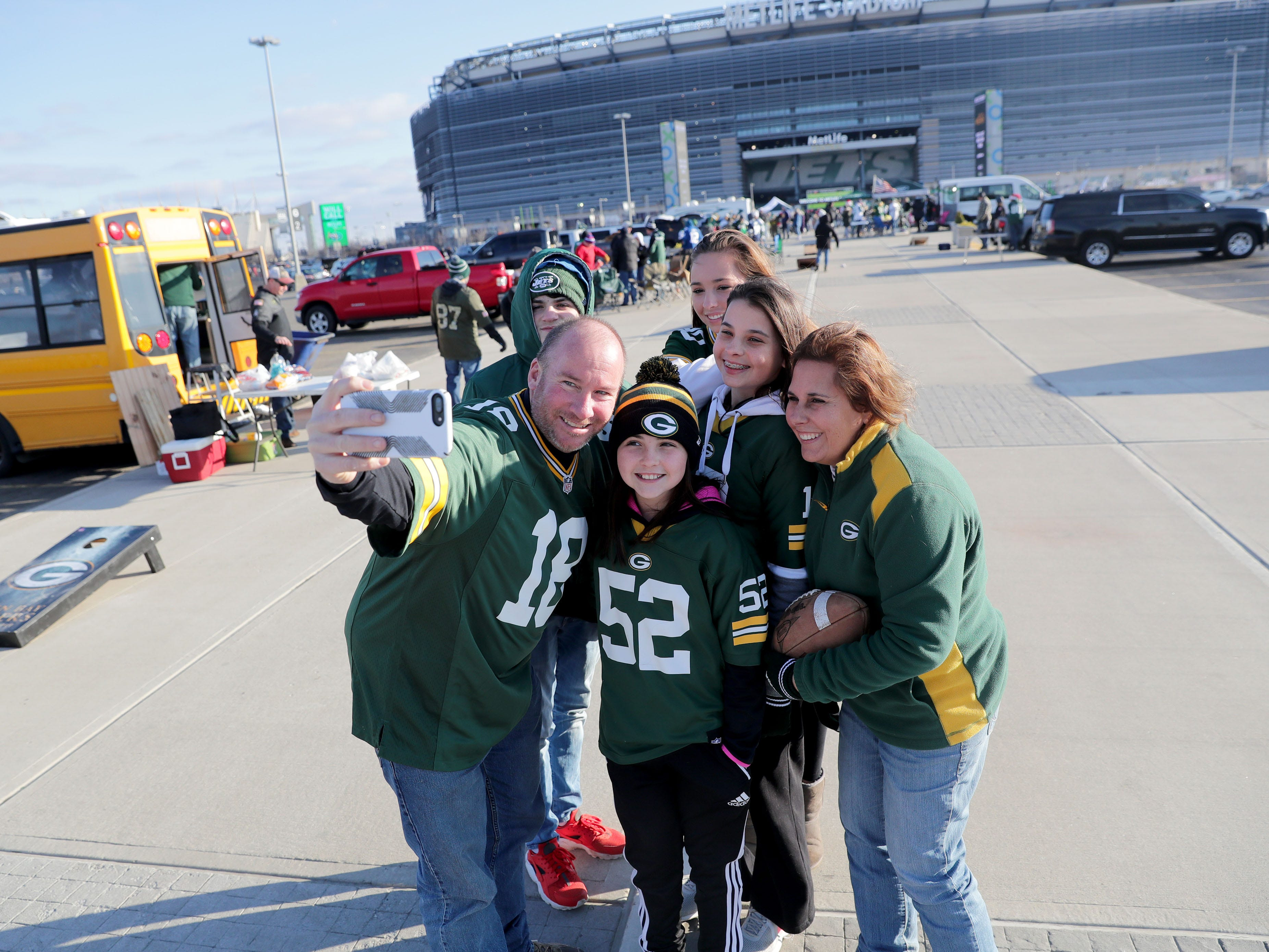 Green Bay Packers fan Joe Buckley, from Limerick, PA, takes a selfie with his family, including his wife, Jen (far right) , their daughters, 10-year-old Erin (52), 14-year-old Lauren (second right), 15-year-old Kelly, and KellyÕs boyfriend 15-year-old Evan Carvo, a New York Jets fan from Greenlane, PA before the Green Bay Packers game against the New York Jets at MetLife Stadium Sunday, Dec. 23, 2018, in East Rutherford.
