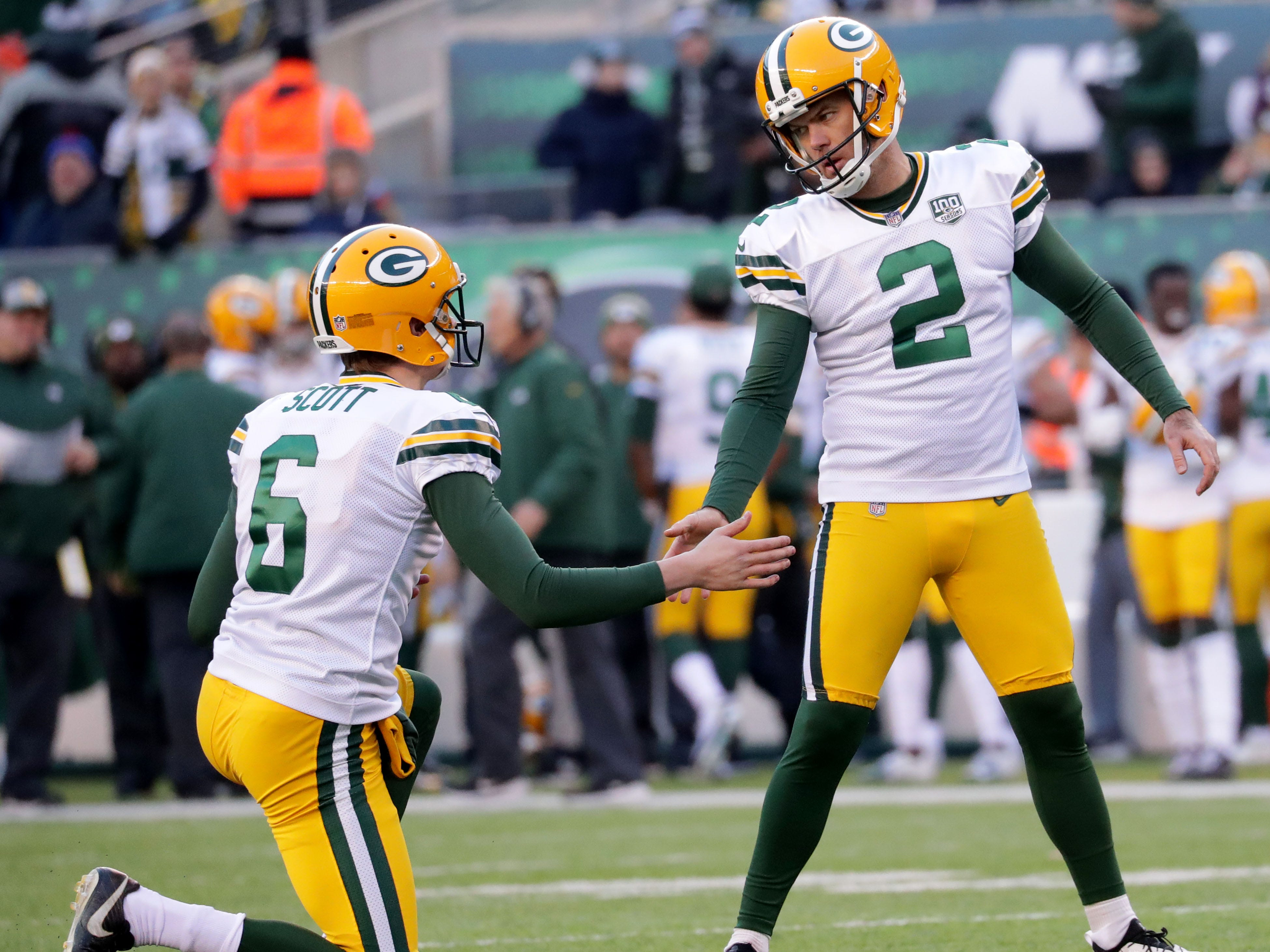 Green Bay Packers' Mason Crosby is congratulated by J.K. Scott for a field goal during the 2nd half of Packers 44-38 overtime win against the New York Jets at MetLife Stadium Sunday, Dec. 23, 2018, in East Rutherford.