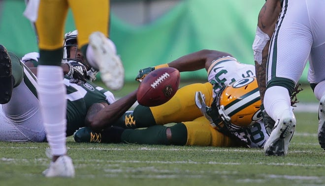 Green Bay Packers' Tramon Williams fumbles a punt that the Packers recovered during first half of the Green Bay Packers game against the New York Jets at MetLife Stadium Sunday, Dec. 23, 2018, in East Rutherford.
