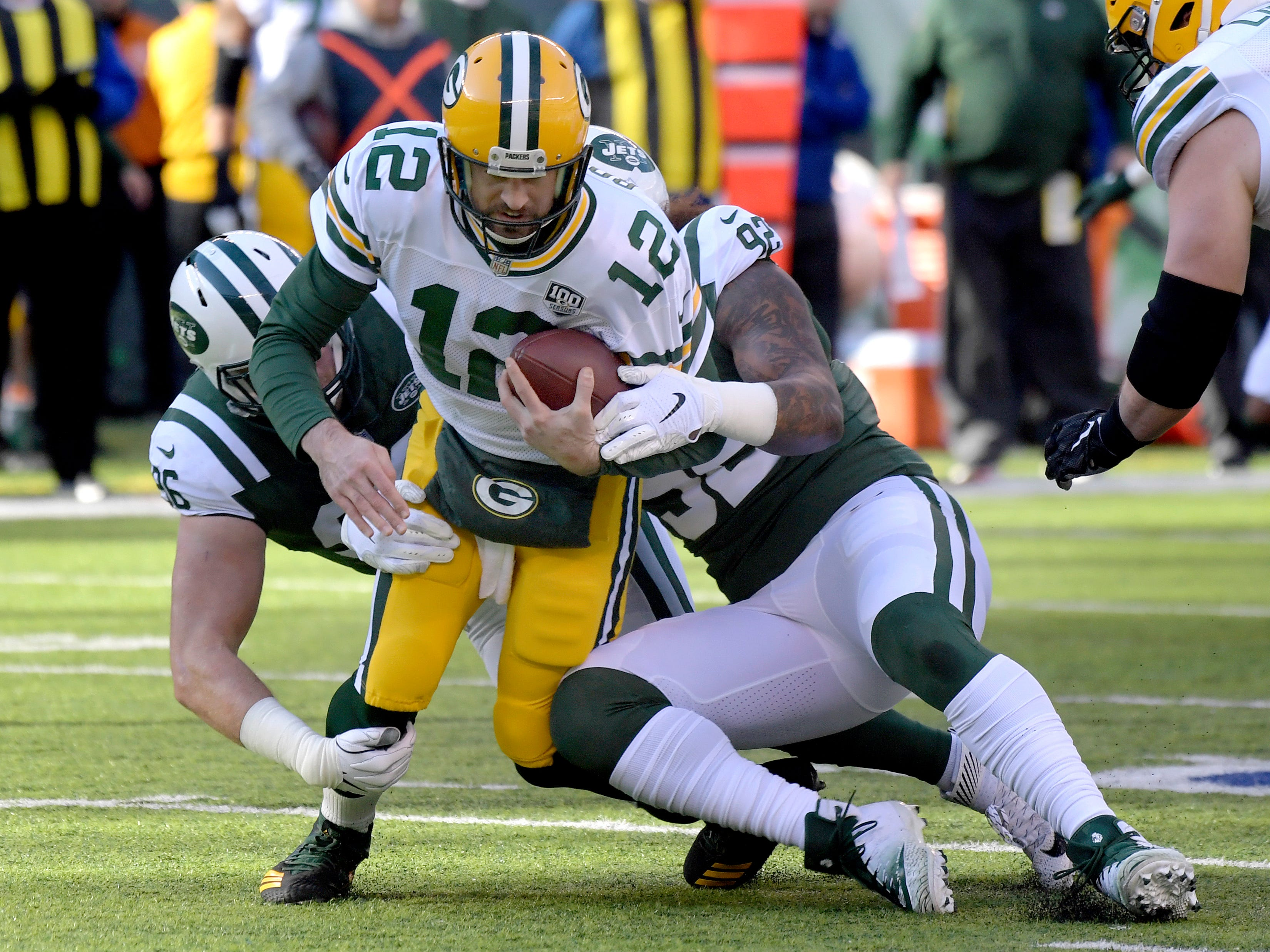 Green Bay Packers quarterback Aaron Rodgers (12) is sacked by New York Jets defensive end Henry Anderson, left, and defensive end Leonard Williams during the first half of an NFL football game, Sunday, Dec. 23, 2018, in East Rutherford, N.J.