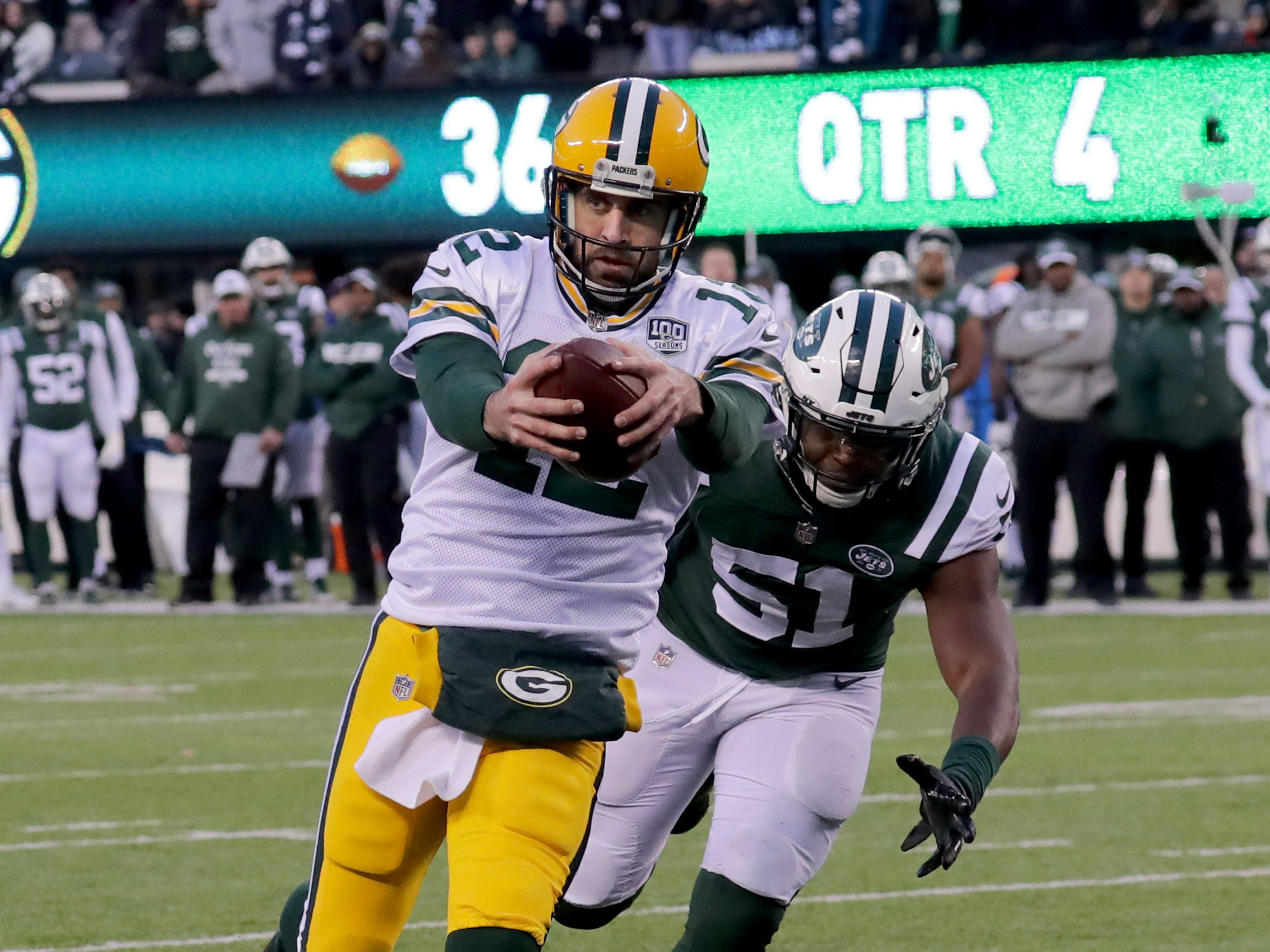 Green Bay Packers' Aaron Rodgers scores a two point conversion  during the 2nd half of Packers 44-38 overtime win against the New York Jets at MetLife Stadium Sunday, Dec. 23, 2018, in East Rutherford.