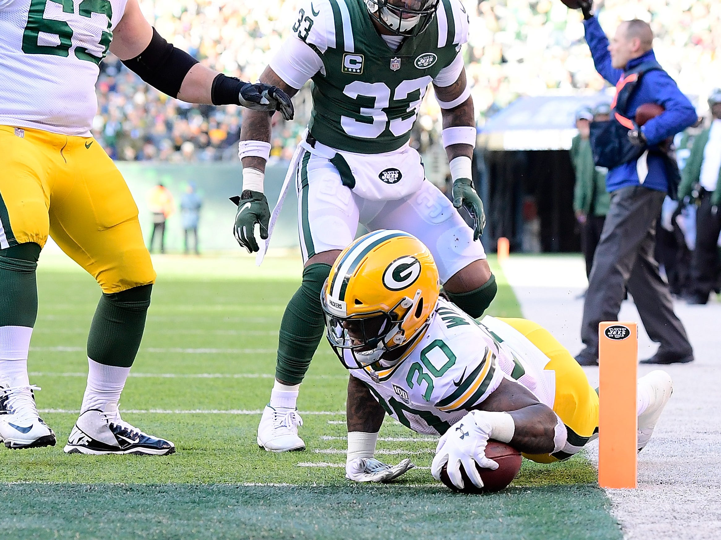Jamaal Williams of the Green Bay Packers scores a touchdown against the New York Jets during the second quarter at MetLife Stadium on December 23, 2018 in East Rutherford, New Jersey.  (Photo by Steven Ryan/Getty Images)