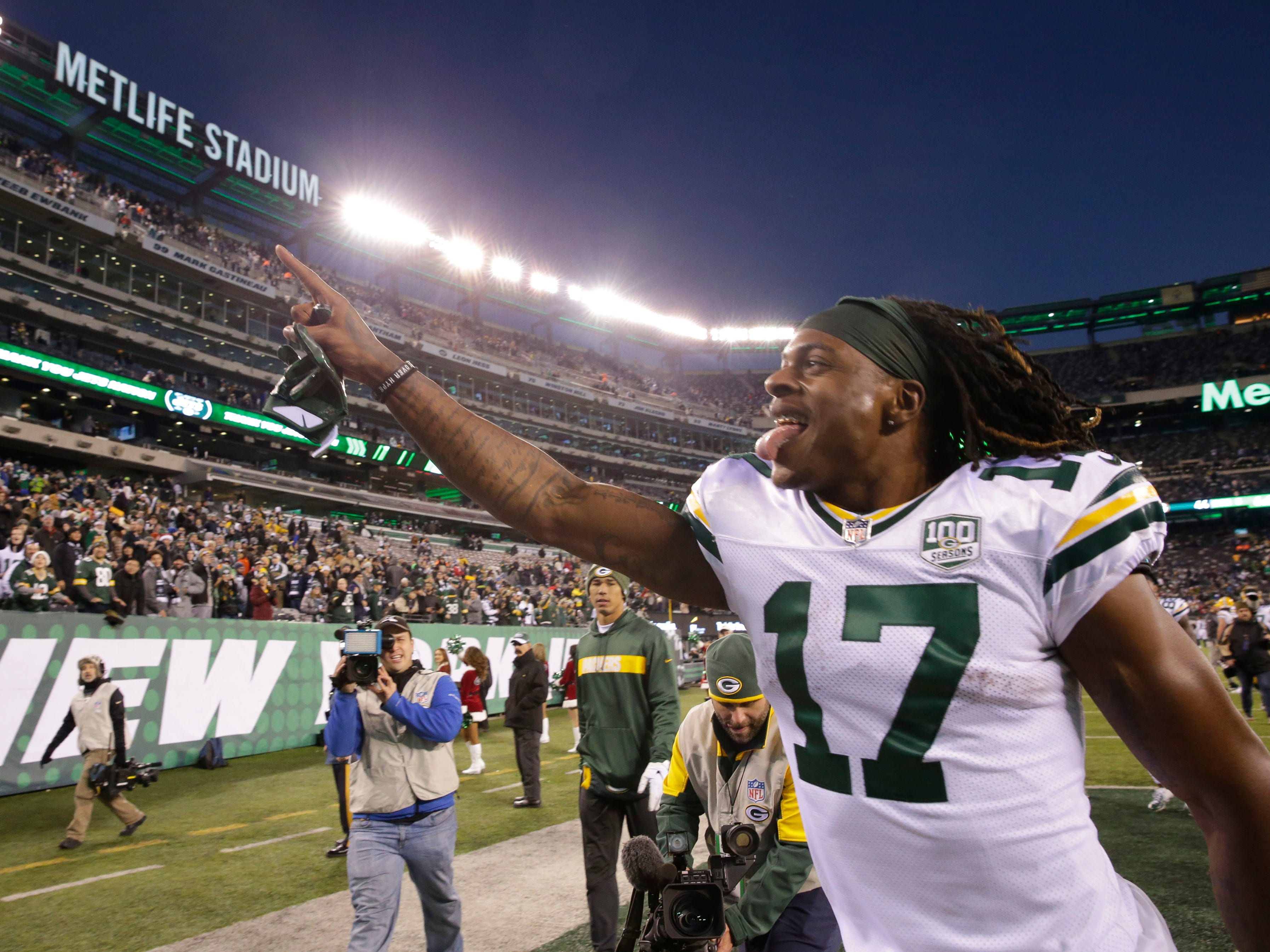Green Bay Packers' Davante Adams responds to the fans after the Packers 44-38 overtime win against the New York Jets at MetLife Stadium Sunday, Dec. 23, 2018, in East Rutherford.