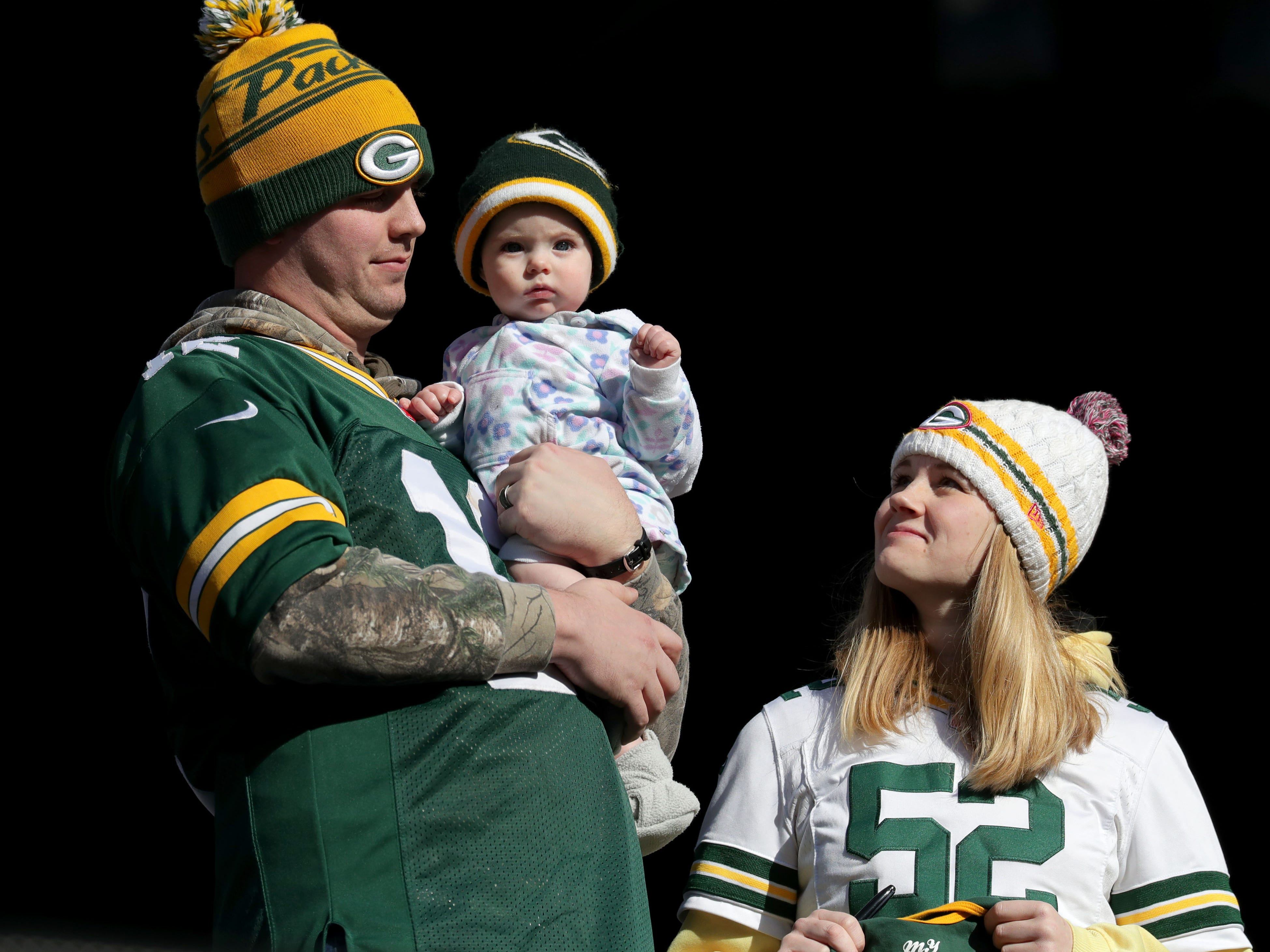 6-month-old Clara Points takes in her first Packers game with her father, Brent and mother (CQ) Mackenzie Points. The family traveled from their hometown of Wausau and were watching the team warm up before the Green Bay Packers game against the New York Jets at MetLife Stadium Sunday, Dec. 23, 2018, in East Rutherford.