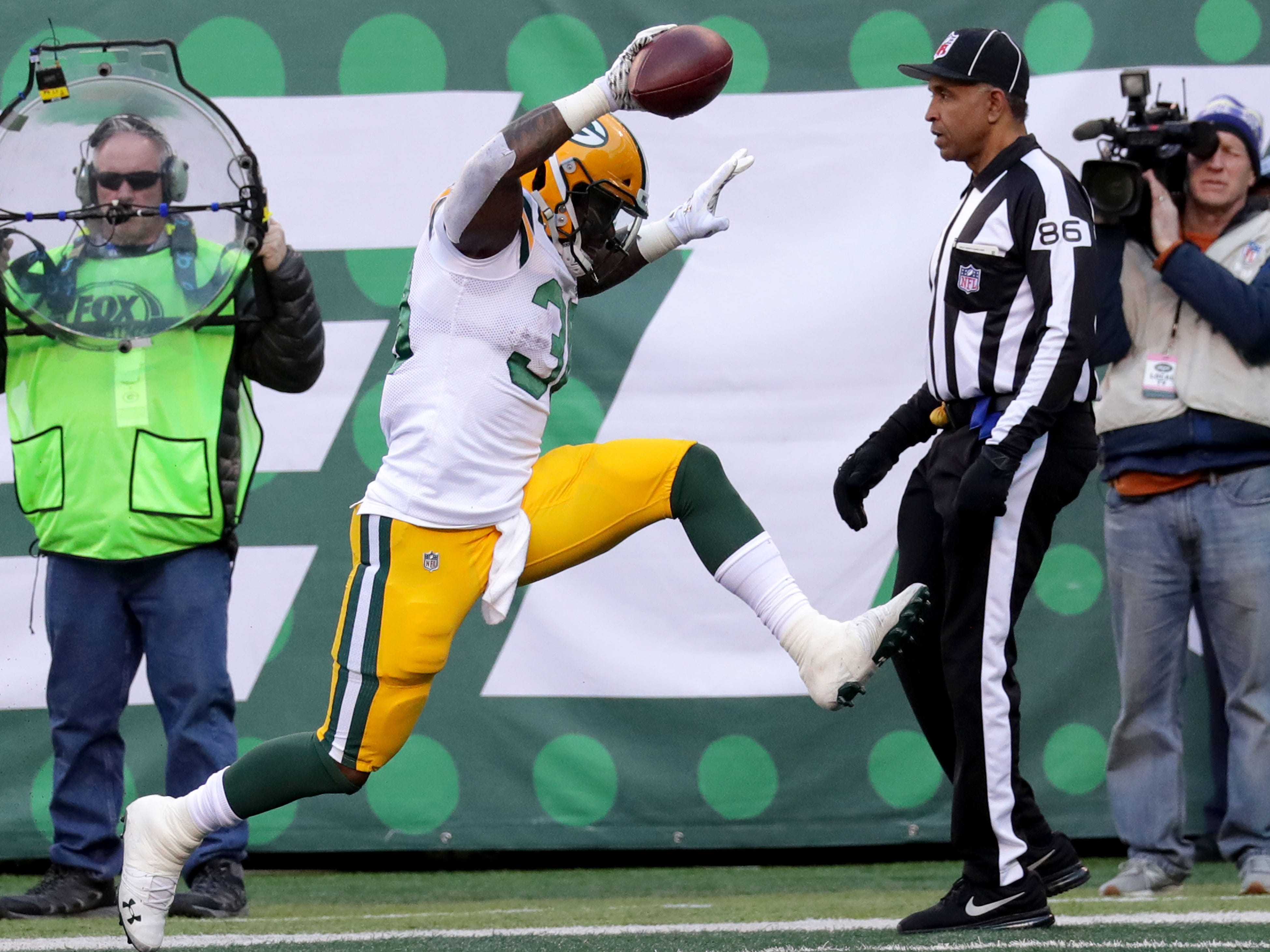 Green Bay Packers' Jamaal Williams (30) celebrates a touchdown during first half of the Green Bay Packers game against the New York Jets at MetLife Stadium Sunday, Dec. 23, 2018, in East Rutherford.