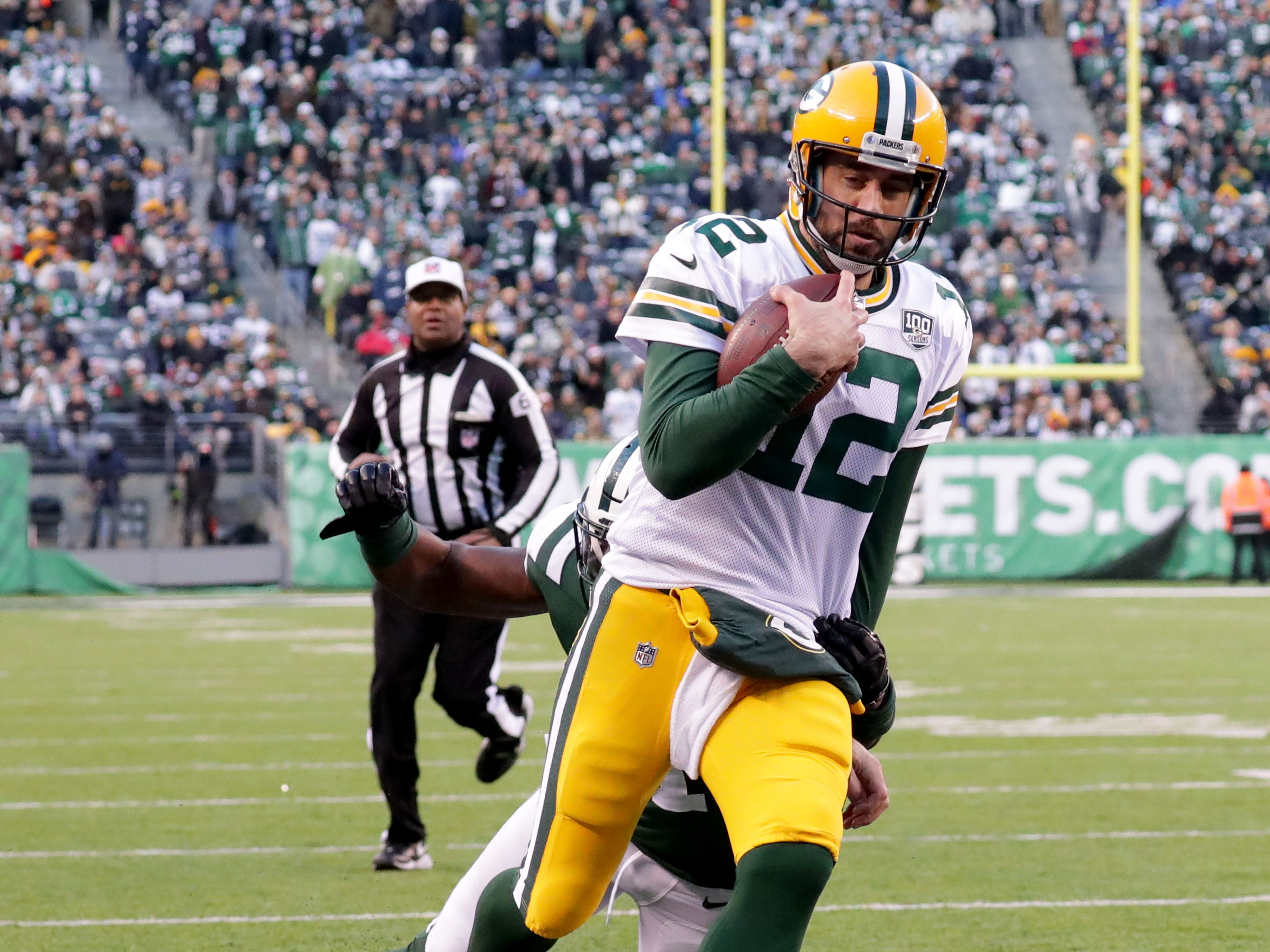 Green Bay Packers' Aaron Rodgers scores a touchdown during the 2nd half of Packers 44-38 overtime win against the New York Jets at MetLife Stadium Sunday, Dec. 23, 2018, in East Rutherford.