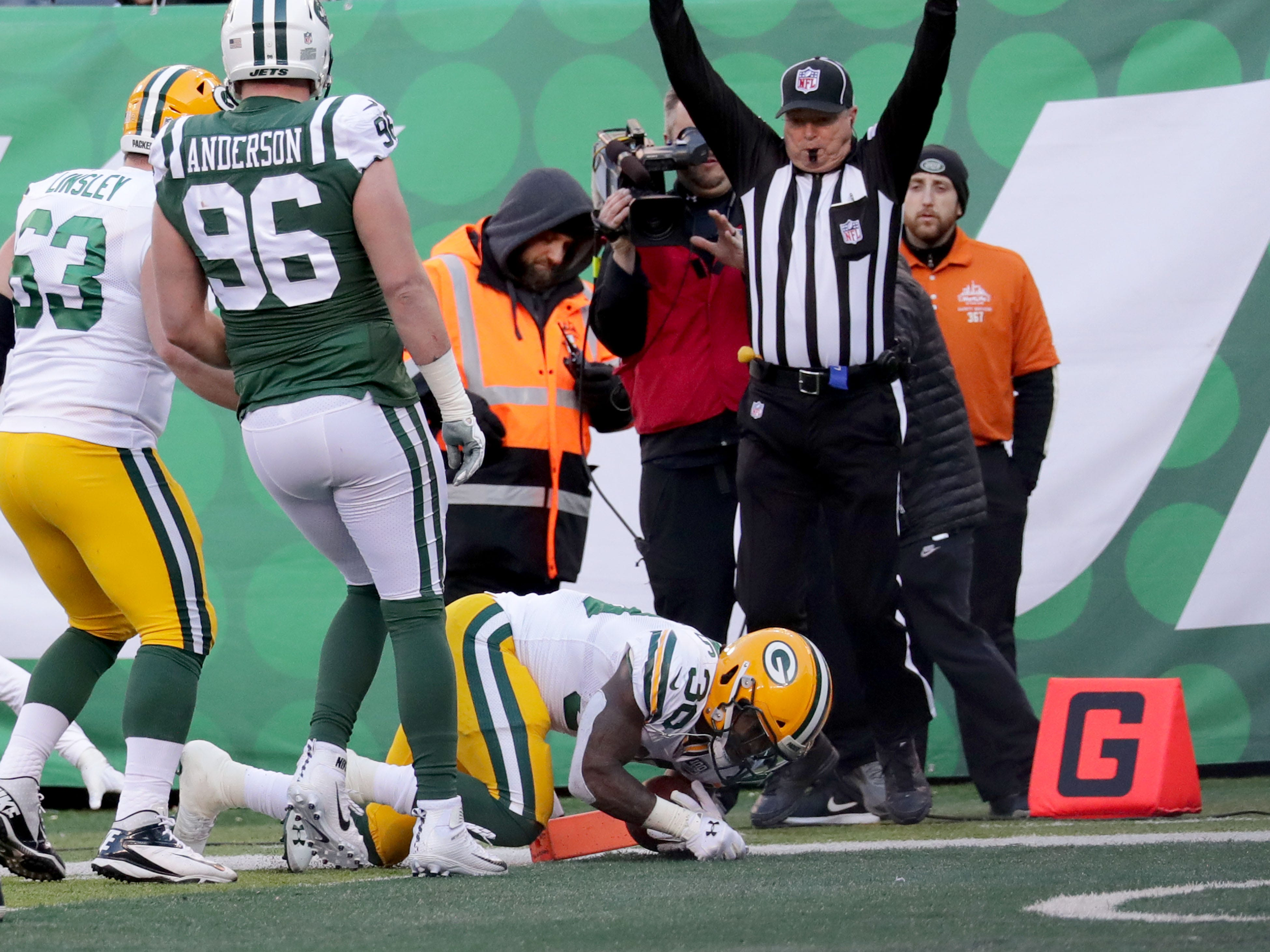 Green Bay Packers' Jamaal Williams (30) scores a touchdown  during first half of the Green Bay Packers game against the New York Jets at MetLife Stadium Sunday, Dec. 23, 2018, in East Rutherford.
