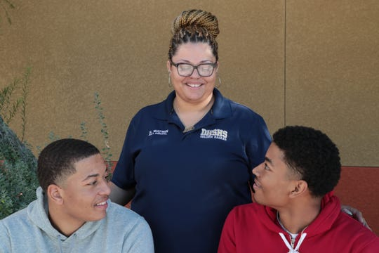 Erica Watson, Assistant Principal at Desert Hot Springs High School, is photographed with her two sons, CJ, left, and Eric. After the death of their father the two are continuing to find comfort and strength playing for the school's basketball team, Desert Hot Springs, Calif., December 17, 2018.