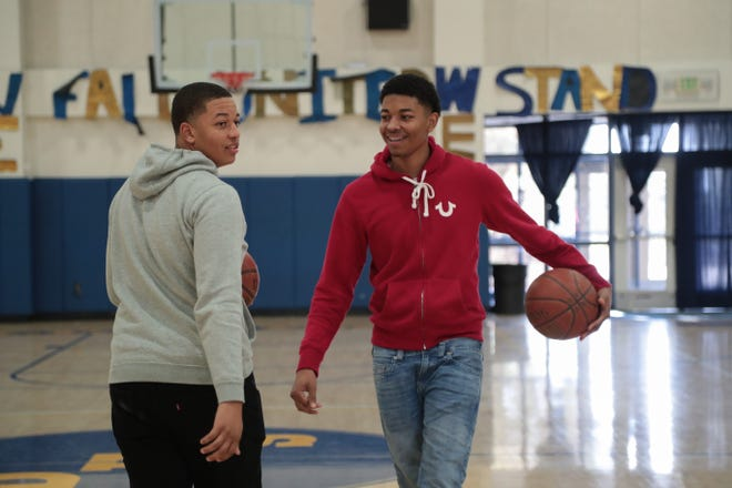 C.J. Watson, left, shoots around with his younger brother Eric at Desert Hot Springs High School, December 17, 2018.