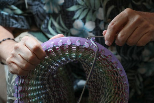 Bob Salisbury uses a knitting loom to knit a hat that he will give to the homeless, La Quinta, Calif., December 17, 2018.