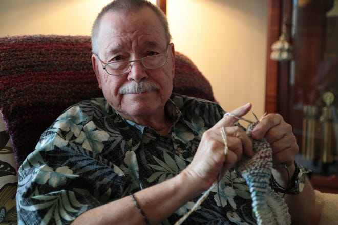 Bob Salisbury works on knitting a scarf that he will give to the homeless, La Quinta, Calif., December 17, 2018.