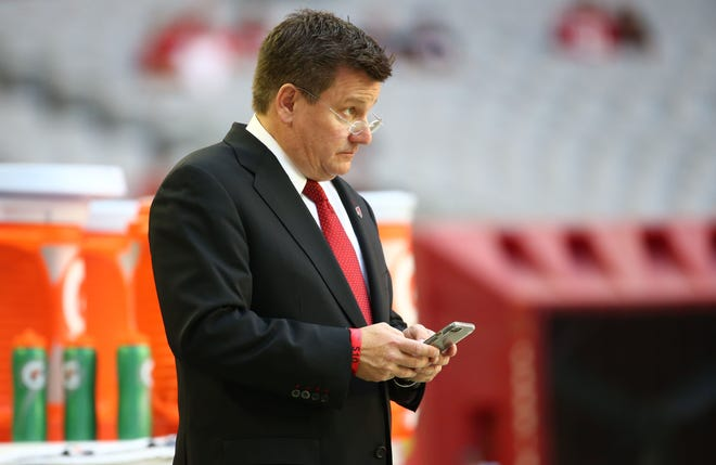 Cardinals president Michael Bidwill looks on from the sideline before a game against Rams on Dec. 23 at State Farm Stadium.