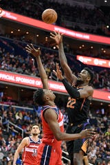 Phoenix Suns center Deandre Ayton (22) shoots against Washington Wizards center Thomas Bryant, left, during the first half of an NBA basketball game, Saturday, Dec. 22, 2018, in Washington. (AP Photo/Nick Wass)