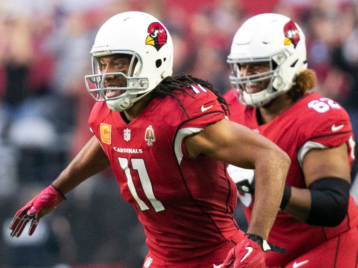 Cardinals wide receiver Larry Fitzgerald reacts after throwing a touchdown pass against the Rams during the second quarter of the NFL game at State Farm Stadium in Glendale on Sunday, December 23, 2018.