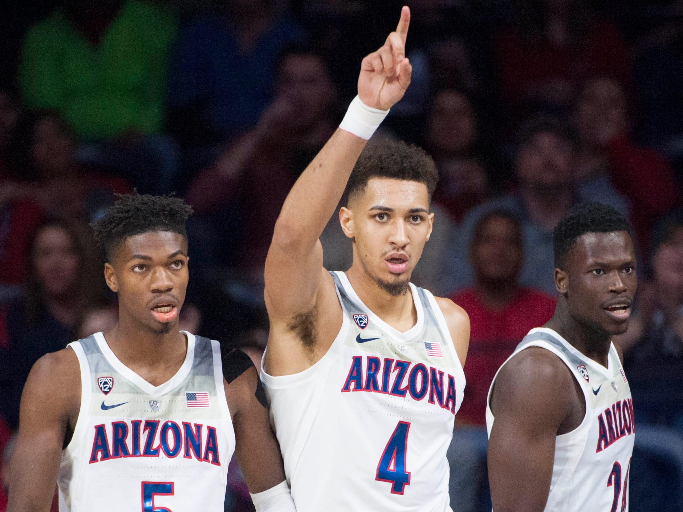 Dec 22, 2018; Tucson, AZ, USA; Arizona Wildcats center Chase Jeter (4) celebrates next to guard Brandon Randolph (5) (left) and guard Emmanuel Akot (24) (right) after scoring against the UC Davis Aggies during the first half at McKale Center. Mandatory Credit: Casey Sapio-USA TODAY Sports