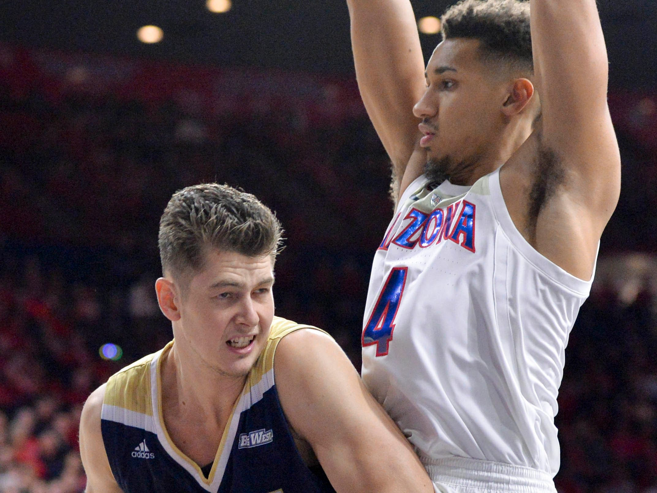 Dec 22, 2018; Tucson, AZ, USA; UC Davis Aggies center Matt Neufeld (13) is defended by Arizona Wildcats center Chase Jeter (4) during the first half at McKale Center. Mandatory Credit: Casey Sapio-USA TODAY Sports