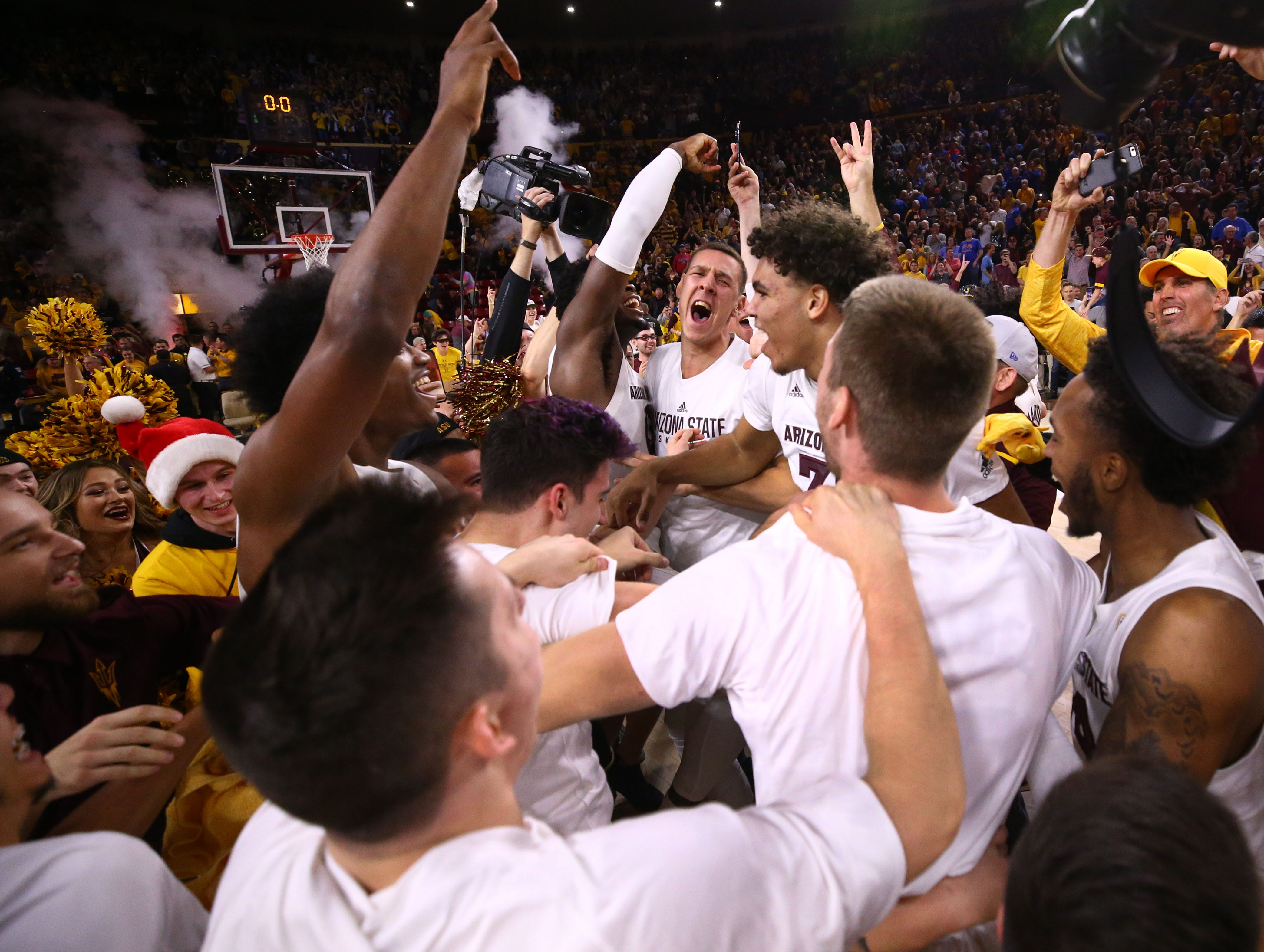 Arizona State celebrates their win over Kansas on Dec. 22 at Wells Fargo Arena.